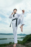 Asian man playing with taekwondo Stock Image