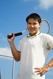 Asian man playing tennis Royalty Free Stock Image