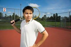 Asian man playing tennis Royalty Free Stock Photos