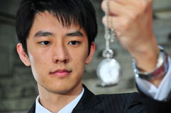 Asian Man with Pocket Watch 3 Stock Images