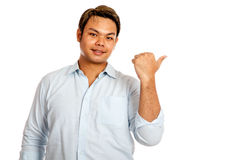 Asian man point to his left with his thumb Stock Images