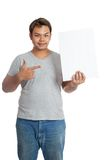 Asian man point to a vertical  blank sign in his hand Royalty Free Stock Photos