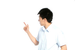 Asian man pointing behind him Royalty Free Stock Photos