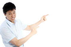 Asian man pointing with both hands Stock Image
