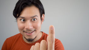 Asian man pointing Royalty Free Stock Images