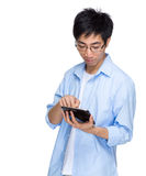 Asian man with portable tablet Stock Photography