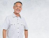 Asian Man Portrait Concrete Wall Background Concept Stock Images