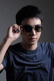 Asian man portrait with retro sunglasses Stock Images