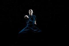 Asian Man practicing Kung Fu Royalty Free Stock Photos