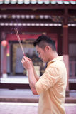 Asian man praying in a temple. Royalty Free Stock Photography