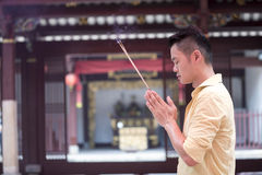 Asian man praying in a temple. Stock Images