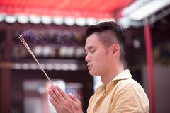 Asian man praying in a temple. Royalty Free Stock Photo