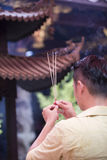 Asian man praying in a temple. Stock Image