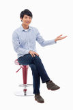 Asian man present something Royalty Free Stock Images