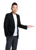 Asian man present something Royalty Free Stock Photography