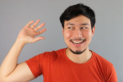 Asian man pretends to pick something up. Stock Photography