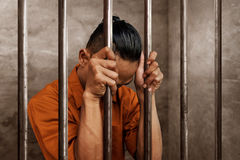 Asian man in prison alone royalty free stock photos