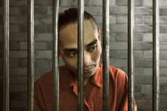 Asian man in prison. Asian man locked in prison Royalty Free Stock Photo