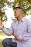 Asian Man Proposing Marriage. On Bended Knee royalty free stock photography
