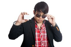 Asian man pull sunglasses off with a card Stock Photo