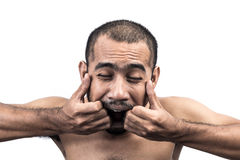 Asian man pulling his mouth widely by hand Stock Photography