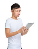 Asian man read on digital tablet Royalty Free Stock Photography