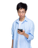 Asian man read text message on mobile phone Royalty Free Stock Photos