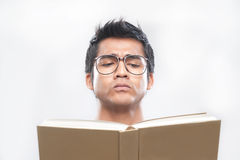Asian Man Reading a book Royalty Free Stock Photos