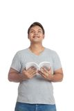 Asian man reading a book looking up imagine Royalty Free Stock Photography