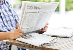 Asian Man Reading The Financial Newspaper. Stock Photo