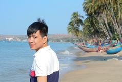 Free Asian Man Relaxing On A Tropical Beach Royalty Free Stock Image - 58600356