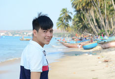 Asian man relaxing on a tropical beach Stock Image