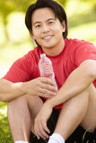Asian man resting after exercise Stock Photo