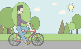 Asian man riding bicycle in park Royalty Free Stock Image