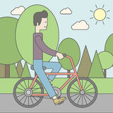 Asian man riding bicycle in park Royalty Free Stock Photos