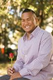 Asian Man with Rose. Asian Man with Red Rose royalty free stock photo