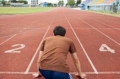 Asian Man Runner On Running Track Stock Images