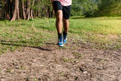 Asian Man running on forest path during sunset, close up legs and feet. Asian Man running on forest path during sunset, close up legs and feet stock images