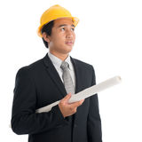 Asian man with safety helmet and blue prints Stock Photo