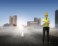 Asian man in safety vest posing Stock Image
