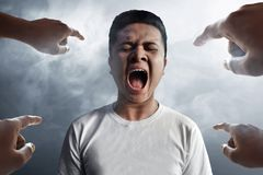 Asian man scream on smoke background Stock Image