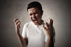 Asian man scream very loud. Asian man screaming very loud Stock Photos