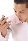 Asian man screaming on cellphone angle Royalty Free Stock Photo