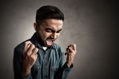 Asian man screaming and mad. Asian man screaming and angry Royalty Free Stock Image