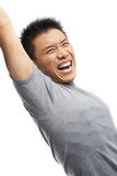 Asian man screaming to express his excitement Royalty Free Stock Images