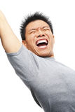 Asian man screaming to express his excitement Stock Photo