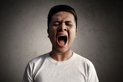 Asian man scream very loud Stock Photography
