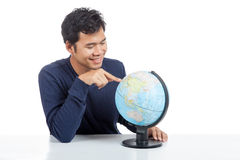 Asian man searching on a world globe Stock Image