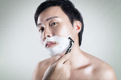 Asian man is shaving Stock Photo