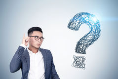 Asian man and shining question mark Stock Image